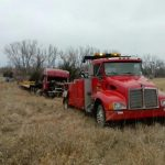 red truck towing